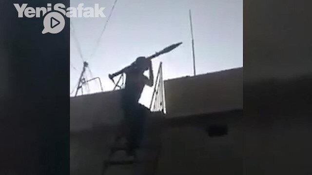 Kamışlı'da sivil kıyafetli teröristin, sivillere ait evin çatısından roketli saldırı anı kamerada
