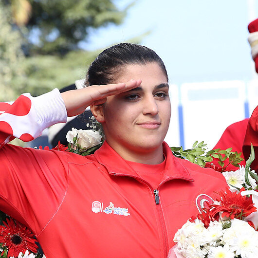 Female  World Boxing  Champion  performs  military salute  for  Turkish  Soldiers in Syria op