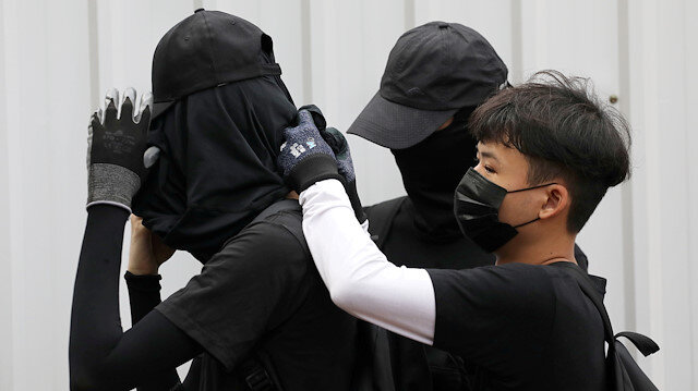 China stops couriers from shipping black clothing to Hong Kong amid protests