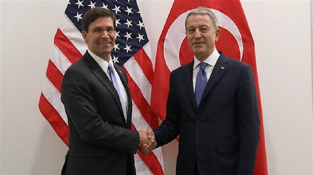 FILE PHOTO: Turkish Defense Minister Hulusi Akar and U.S. Defense Secretary Mark Esper (L)