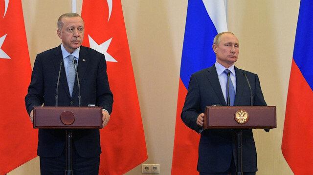 Turkish President Tayyip Erdogan and Russian President Vladimir Putin attend a news conference following their talks in Sochi