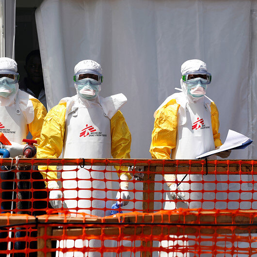 UN migration body suspends some Ebola screening after 3 aid workers killed