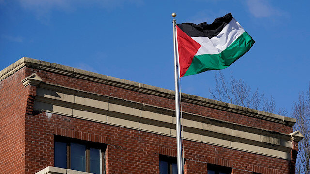 File photo: Palestinian flag waves at Palestine Liberation Organization office in Washington