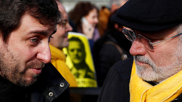 Dismissed Catalan politicians Toni Comin and Lluis Puig.