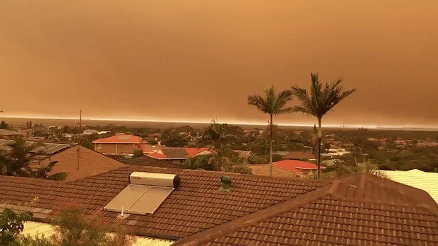 Smoke with orange tint blanketing skies and orange hues are seen from a kitchen window in Port Macquarie, Australia November 8, 2019.