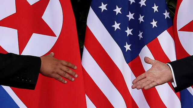 FILE PHOTO: U.S. President Donald Trump and North Korea's leader Kim Jong Un meet at the start of their summit at the Capella Hotel on the resort island of Sentosa, Singapore June 12, 2018.