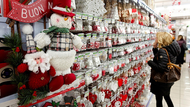 A woman looks at Christmas decorations in a shop in Rome, Italy.