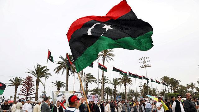 Libyan man waves a Libyan flag