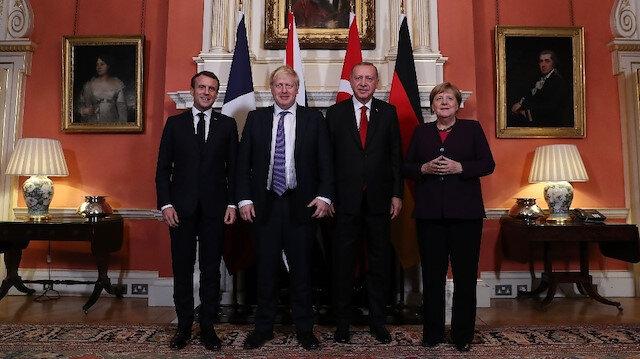 Erdoğan, Macron, Merkel ve Johnson ile bir araya geldiği Dörtlü Zirve'de Suriye uzlaşması