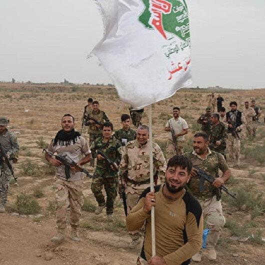 العراق.. مسلحون تابعون للصدر يهددون بالرد على مستهدفي مقره