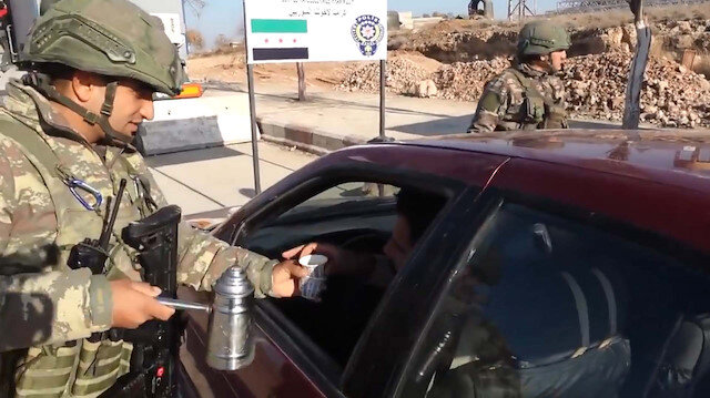 Turkish soldiers offer hot drinks at Syria checkpoints
