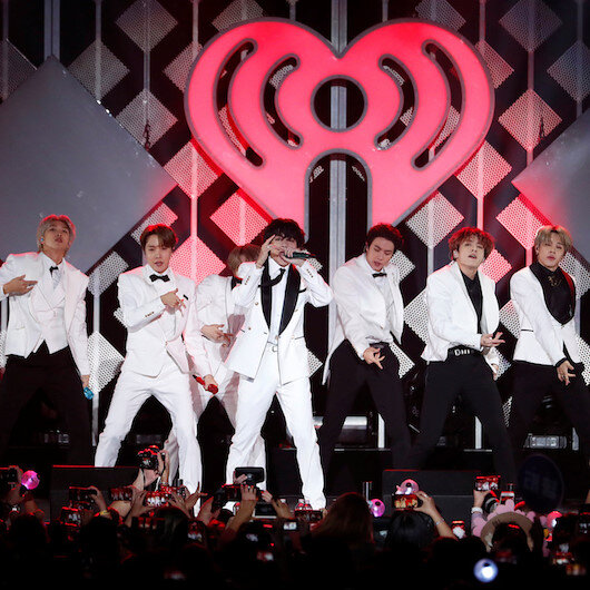K-Pop's BTS scores another first as tour microphones head to auction