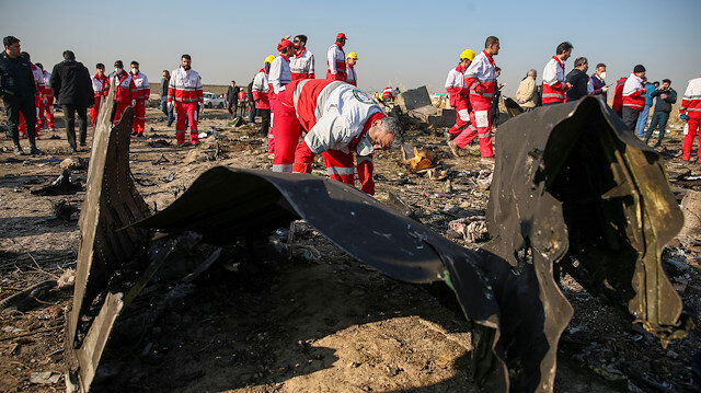 File phto: Red Crescent workers check the debris from the Ukraine International Airlines plane, that crashed after take-off from Iran's Imam Khomeini airport, on the outskirts of Tehran, Iran January 8, 2020