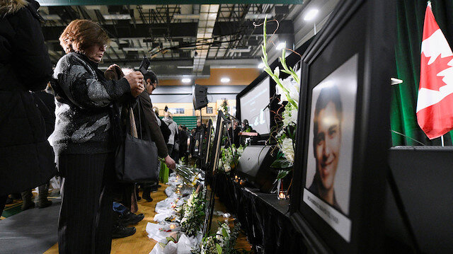 Flowers and photos of the victims set up at a memorial service