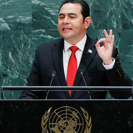 Protesters throw eggs, jostle outgoing Guatemalan president