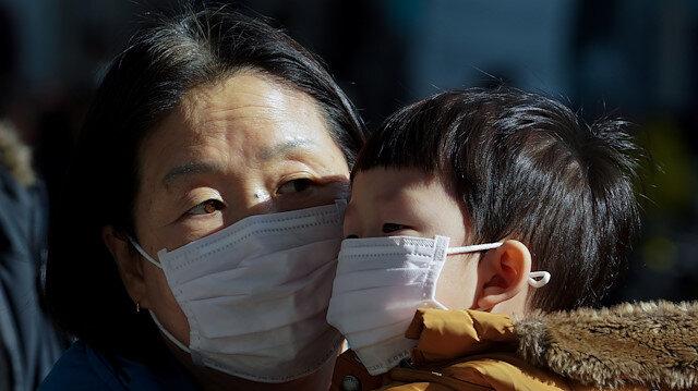 Coronavirus deaths hit 56; China bans wildlife trade