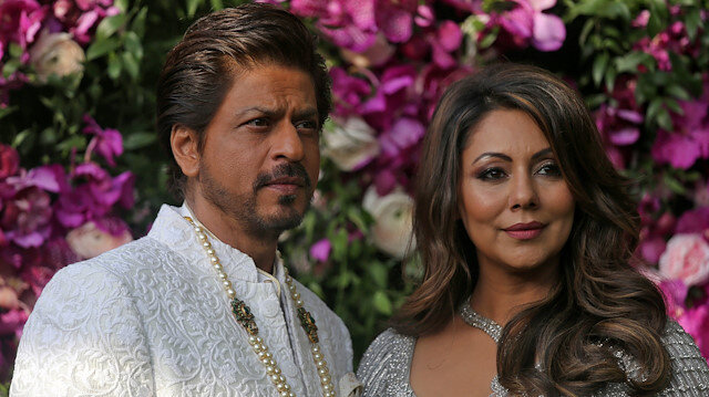 Bollywood actor Shah Rukh Khan and his wife Gauri pose during a photo