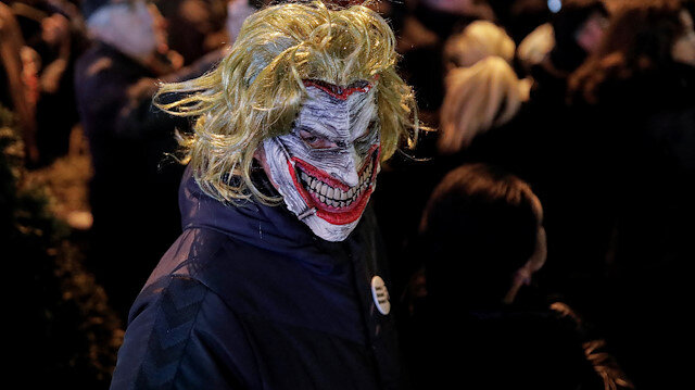 A demonstrator wearing the DC comic Joker character's mask attends a protest against Serbian President Aleksandar Vucic and his government in central Belgrade, Serbia, December 7, 2019. REUTERS/Marko Djurica