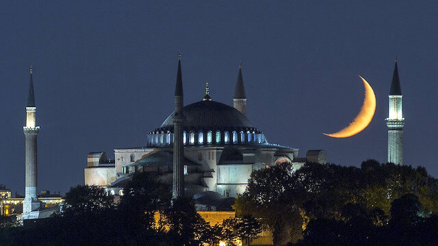 Hagia Sophia at night with crescent moon in the sky in Istanbul, Turkey