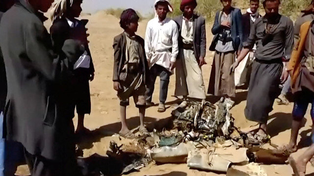 People inspect purported plane crash site in, said to be, Al-Jawf, Yemen