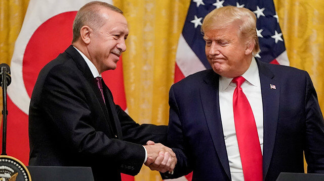FILE PHOTO: U.S. President Donald Trump greets Turkey's President Tayyip Erdogan during a joint news conference at the White House in Washington, U.S., November 13, 2019. REUTERS/Joshua Roberts/File Photo