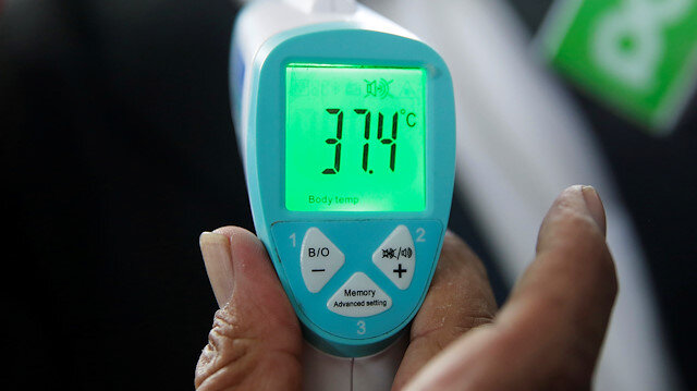 An infrared thermometer shows test temperature dates during a campaign
