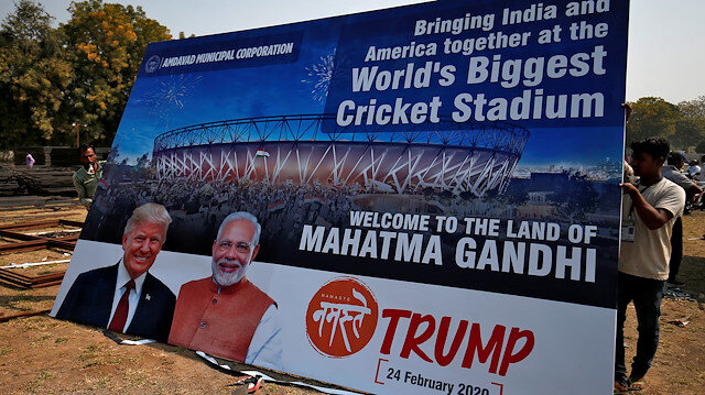 Workers prepare a hoarding with the images of the U.S. President Donald Trump and India's Prime Minister Narendra Modi ahead of Trump's visit, on the outskirts of Ahmedabad, India, February 19, 2020. REUTERS/Amit Dave