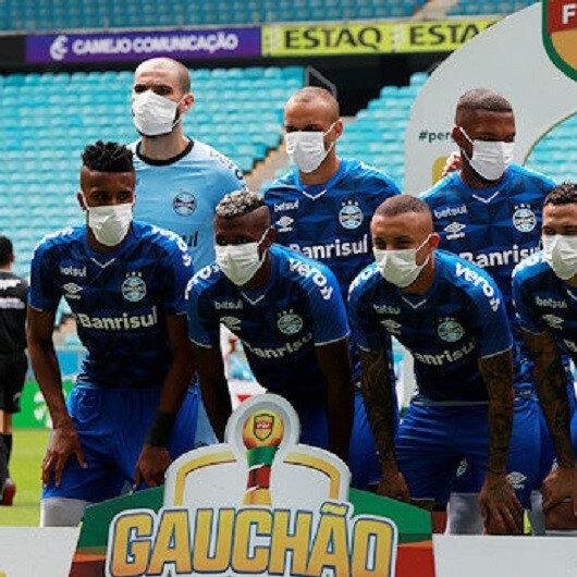 Brazilian team threaten strike after masked protest