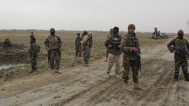 Afghan National Army (ANA) soldiers arrive at the site of last night clashes