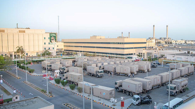 Medical vehicles to be used as field hospital, are seen at the parking of the King Fahad Hospital