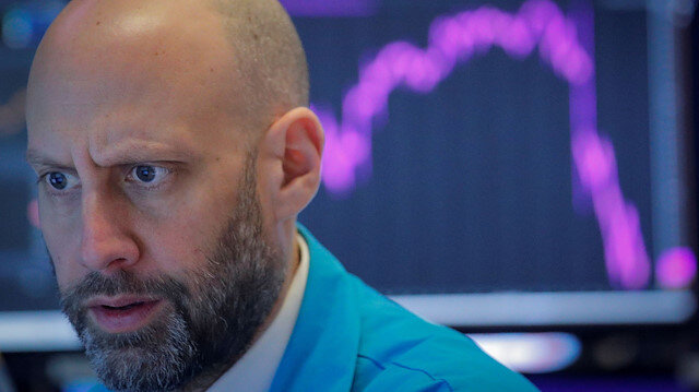 A trader works on the floor of the NYSE on Feb 27, 2020. Wall Street's main indexes