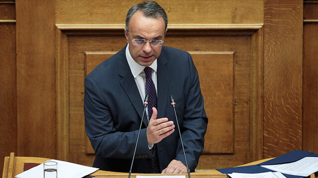 FILE PHOTO: Greek Finance Minister Christos Staikouras addresses lawmakers during a parliamentary session before a budget vote in Athens, Greece, December 18, 2019. REUTERS/Costas Baltas/File Photo