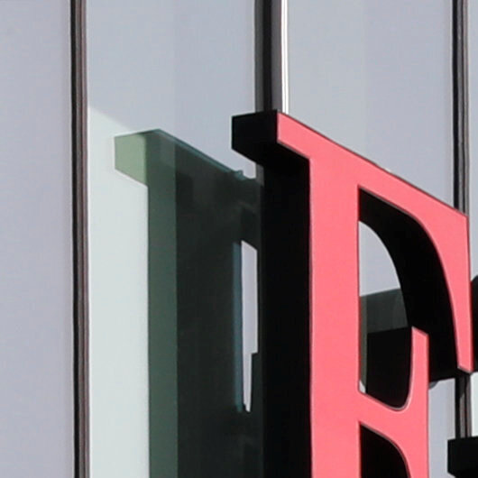 Fitch downgrades UK's rating with outlook negative