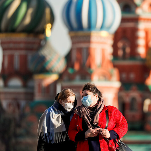 Russia reports more COVID cases, deaths