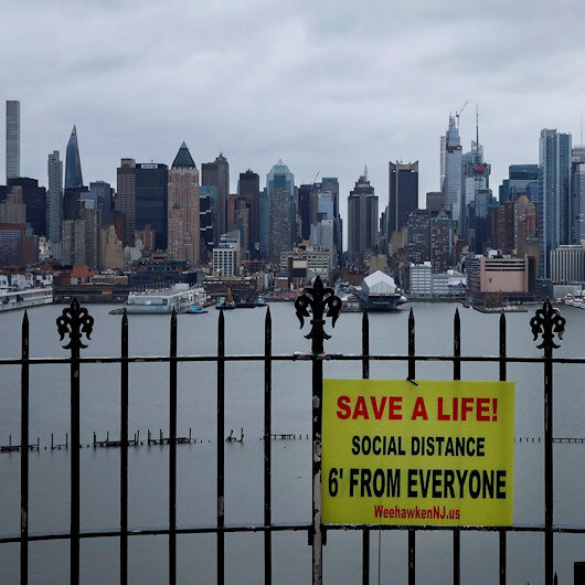 New York in 'race against time' as death tolls jump in US virus hot spots