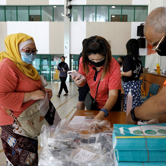 Singapore reports 120 new coronavirus cases in record daily jump
