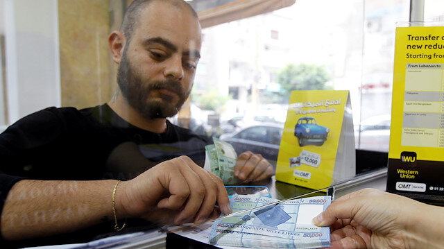 Lebanese banks set rate of 3,000 pounds per dollar for withdrawals ...