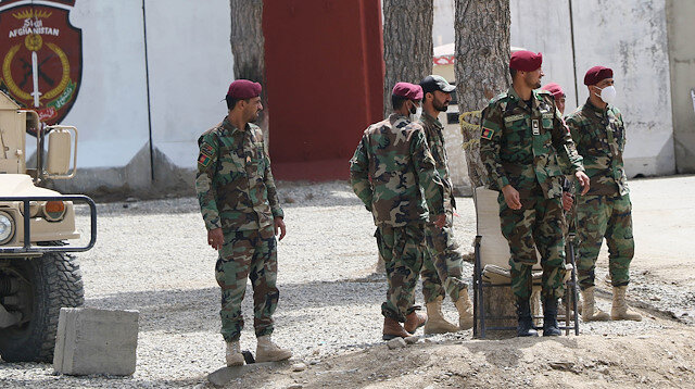 File photo: Afghan police officers are seen at a scene of a suicide bomb attack