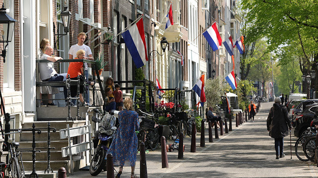 Dutch flags hang outside apartments to celebrate King's Day (Koningsdag)