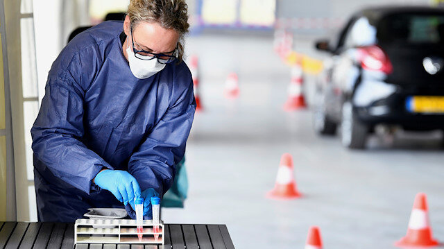 File photo: A member of medical staff takes coronavirus test samples during drive-thru coronavirus disease (COVID-19) testing, on a converted ice rink, in Alkmaar, Netherlands April 8, 2020