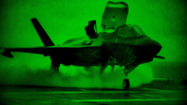 A U.S. Marines F-35B Lightning II fighter aircraft launches from the U.S. Navy amphibious assault ship USS America during low-light flight operations in the Philippine sea April 6, 2020. Picture taken April 6, 2020. U.S. Marine/Lance Cpl. Kolby Leger/Handout via REUTERS. THIS IMAGE HAS BEEN SUPPLIED BY A THIRD PARTY.