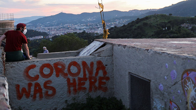 File photo: A man wears a protective face mask at a lookout point as a general view of the city of Barcelona is seen in the background, as the spread of the coronavirus disease (COVID-19) continues, in Barcelona, Spain May 6, 2020.