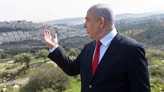 Israeli Prime Minister Benjamin Netanyahu delivers a statement overlooking the Israeli settlement of Har Homa, located in an area of the Israeli-occupied West Bank on February 20, 2020.