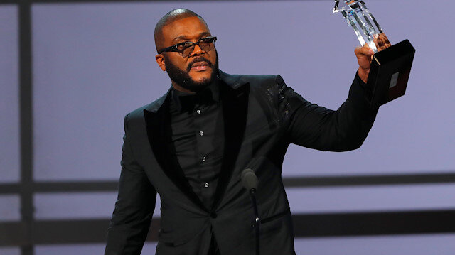 FILE PHOTO: Movie mogul Tyler Perry accepts the Ultimate Icon award at the 2019 BET Awards in Los Angeles, California, U.S., June 23, 2019 - REUTERS/Mike Blake/File Photo