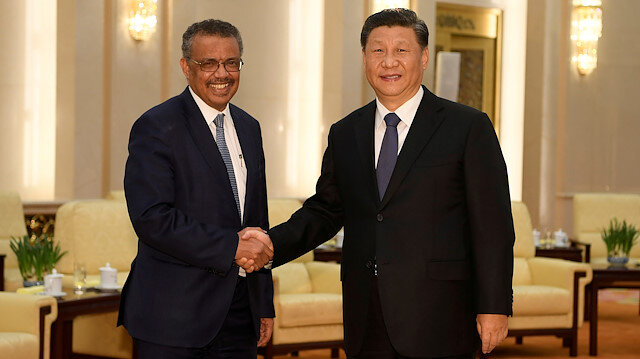 Tedros Adhanom, director general of the World Health Organization, shakes hands with Chinese President Xi jinping before a meeting at the Great Hall of the People in Beijing, China
