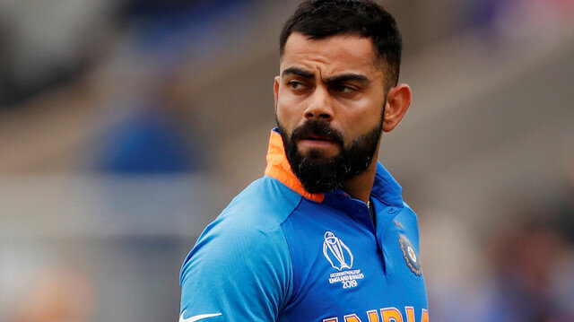FILE PHOTO: Cricket - ICC Cricket World Cup Semi Final - India v New Zealand - Old Trafford, Manchester, Britain - July 10, 2019 India's Virat Kohli reacts after losing his wicket Action Images via Reuters/Lee Smith/File Photo