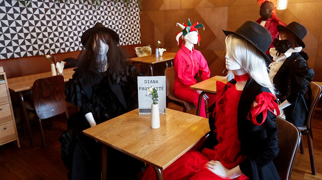 Mannequins dressed in creations of local designer sit at the table in a restaurant during the coronavirus disease (COVID-19) outbreak in Vilnius, Lithuania May 21, 2020. REUTERS/Ints Kalnins