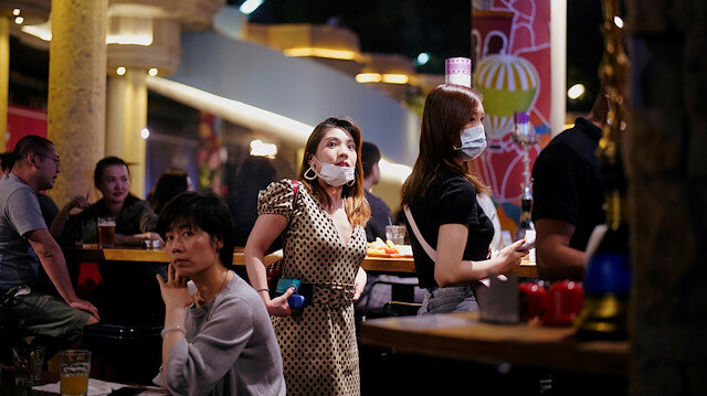 People wearing face masks are seen at a bar area in a nightclub after it reopens, following a shutdown due to the coronavirus disease (COVID-19) outbreak, in Shanghai, China May 22, 2020. Picture taken May 22, 2020. REUTERS/Aly Song