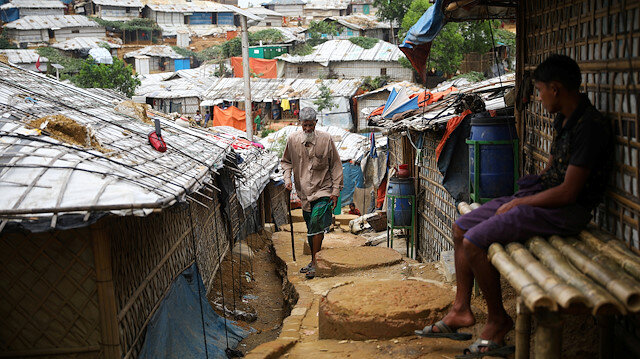 FILE PHOTO: A Rohingya refugee walks at a refugee camp in Cox's Bazar, Bangladesh, March 7, 2019