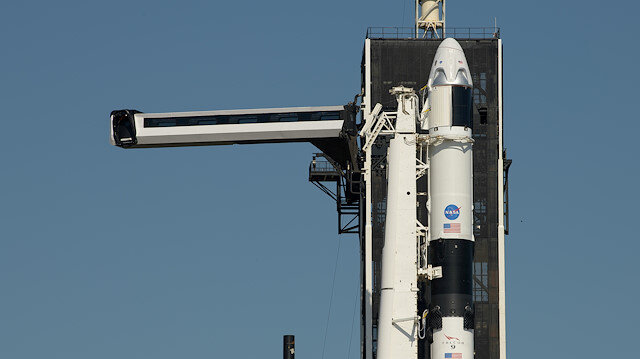 The crew access arm is swung into position to a SpaceX Falcon 9 rocket